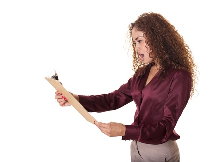 Female office worker is surprised by what she sees on her clipboard  Isolated on white background