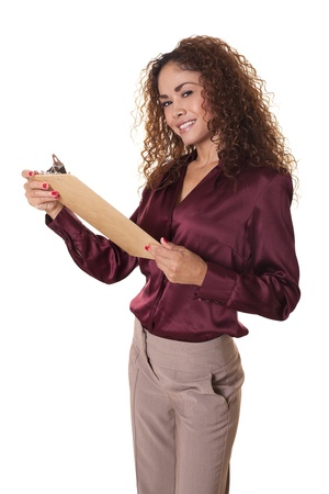 Office worker stands, smiling with a clipboard  Stock fotó