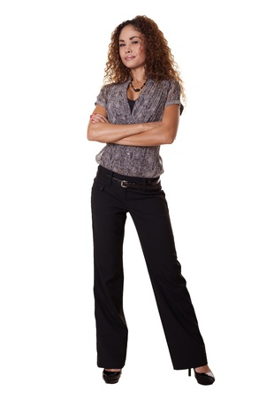 confidently: Ethnic woman stands confidently with arms crossed   Stock Photo
