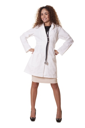 20 s: Female Doctor with a friendly smile poses with her hands on her hips, isolated on white background