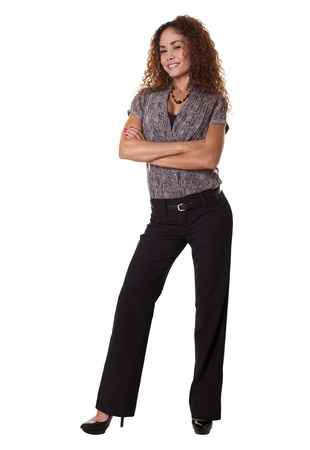 Trendy female office worker stands smiling with arms crossed   Stock fotó