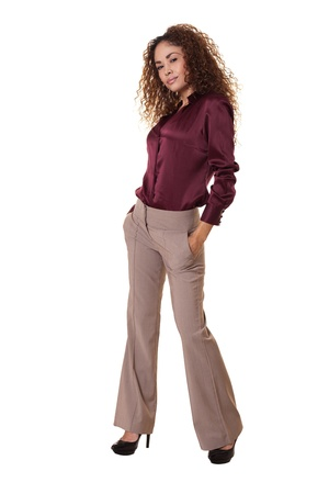 Ethnic woman stands confidently with hands in pockets