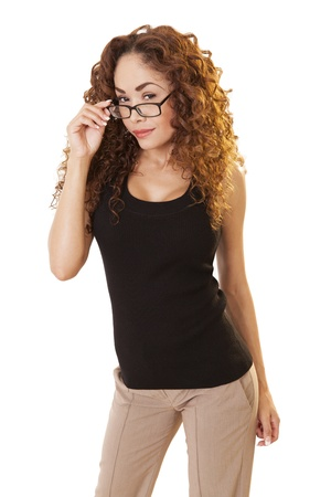 Beautiful woman looks over her glasses with a skeptical look, isolated on white background