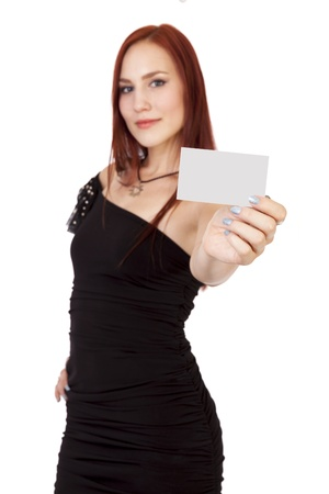 Young woman in a little black dress holds a blank business card