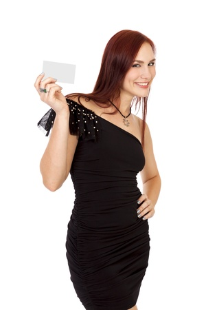 Happy young woman in a little black dress, holds a business card