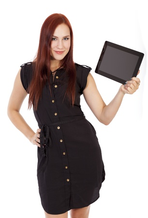 Pretty young woman in a blue dress smiles while holding a tablet computer