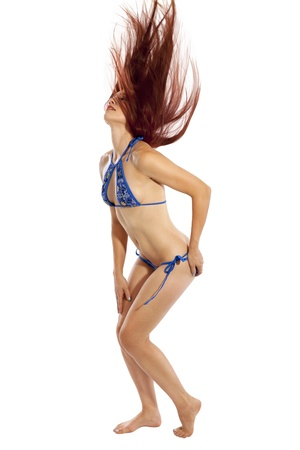 hottie: A fit woman in a small bikini whips her red hair into the air