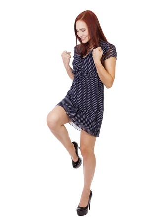 Young woman in a blue dress and black heels does the victory pose, yes I won Stock fotó - 40661217