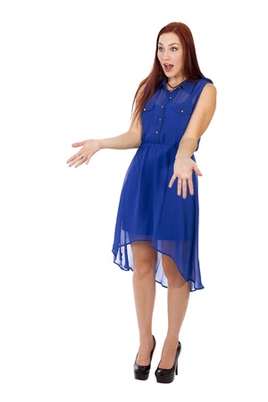 Pretty young woman with long red hair hods her arms out with her mouth open in shock Stock fotó - 40661224