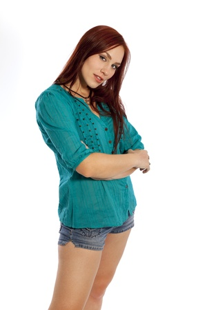 Pretty young woman in shorts and a summer shirt standing with arms crossed Stock fotó - 40661240