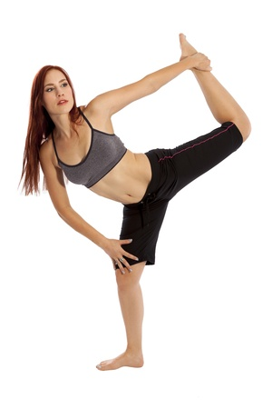 capri pants: Pretty fitness model does an advanced stretch in her workout clothes  Stock Photo