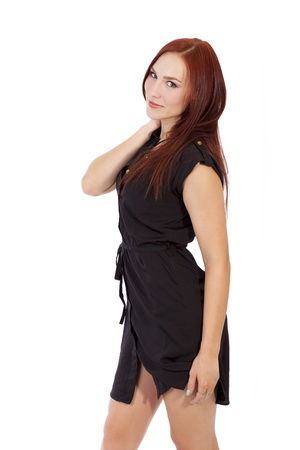 Pretty young woman touches her long red hair Stock fotó - 40661270