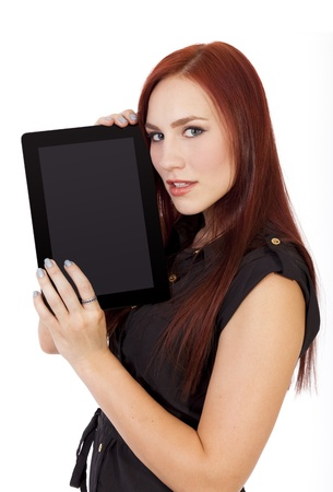 hottie: Pretty young woman with long red hair holding a tablet computer  Stock Photo