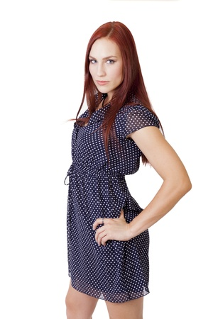 hottie: Pretty young woman in a blue dress stands with confidence