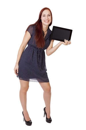 hottie: A young woman with long red hair smiles while holding a tablet computer horizontally  Stock Photo