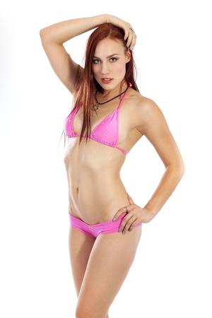bikini slender: Attractive young woman in a small bikini poses in her bikini with confidence