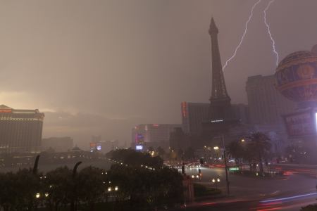 high winds: LAS VEGAS - JULY 19, 2013 - Vegas Strip on July 19, 2013 in Las Vegas  A powerful storm pummels the Vegas Strip with torrential rain, lightening and high winds, forcing tourists to run for cover