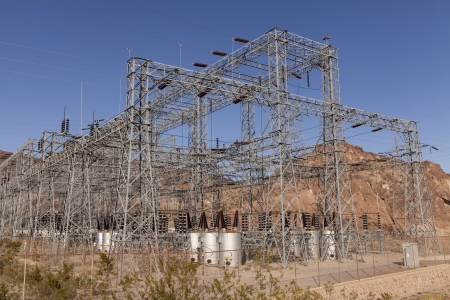 Huge power transformers manage the electricity from Hoover Dam  An electric buzzing sound fills the air  Banco de Imagens