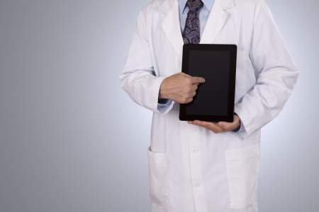 A Physician gives a demonstration with his tablet computer  Negative space on left side for copy Stock Photo - 23283600