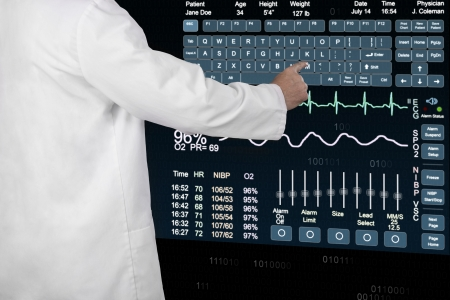 A Physician uses a virtual computer to enter a patients information Stock Photo - 23283604