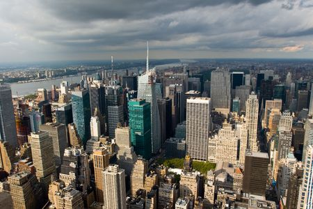 Skyline of New York City under the sun when the rain is comming. photo