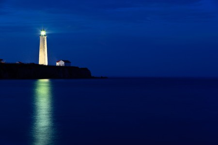 Twilight on Cap-des-Rosiers Lighthouse in forillon National Park.  Quebec, Canada photo