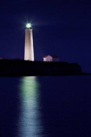 Night shoot of Twilight on Cap-des-Rosiers Lighthouse in forillon National Park.  Quebec, Canada photo