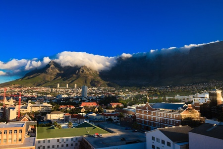 By a beautiful summer, a big cloud has formed on the Table Mountain in Cape Town, South Africa. photo