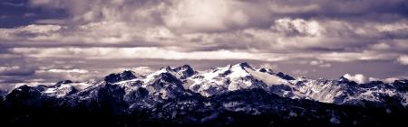whistler: Panoramic shot of a mountain covered by snow under nice cloudy sky