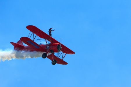 Bagotville, Canada- June 22, 2013: The Bagotville Airshow is a 2 days airshow where the Bagotville Airport opens to the public with a variety of aerial performers as well as aircraft and vehicles on display. This image shows Carol Pilon wing walker during