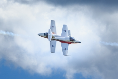 armed forces: Bagotville, Canada- June 22, 2013: The Bagotville Airshow is a 2 days airshow where the Bagotville Airport opens to the public with a variety of aerial performers as well as aircraft and vehicles on display. This image shows The Canadian Snowbirds aerial