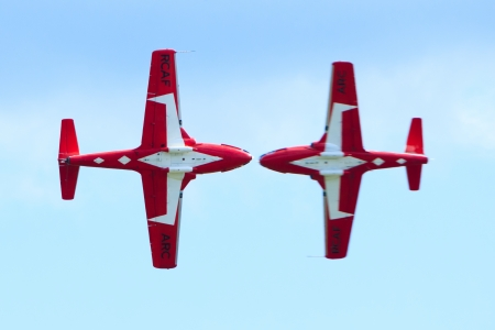air demonstration: Bagotville, Canada- June 22, 2013: The Bagotville Airshow is a 2 days airshow where the Bagotville Airport opens to the public with a variety of aerial performers as well as aircraft and vehicles on display. This image shows The Canadian Snowbirds aerial