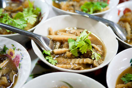 Braised Fish Maw in Red Gravy serve in small dish Stock Photo