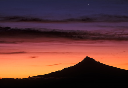 mt  hood: A silhouette of Mt. Hood stands strong agains the vibrant sunrise colors.