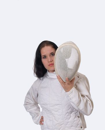 Young woman holding fencing mask in jacket      Reklamní fotografie