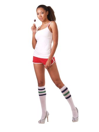 Woman in shorts and shirt with lollipop
