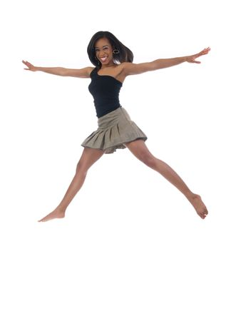 Young black woman in skirt and black top jumping