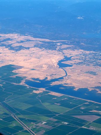 Arial View of Fields and Delta Area with foothills   Stock Photo