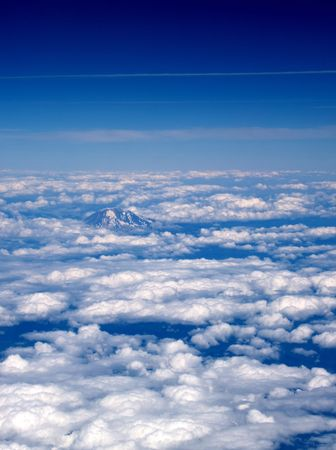 Arial View of Mount Top surrounded by Clouds