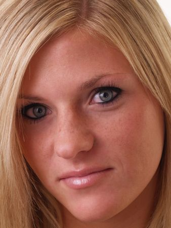 Blue-eyed blond young woman in closeup portrait