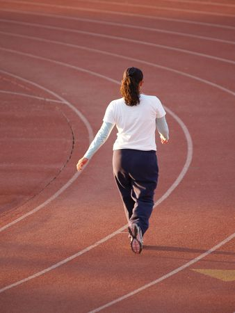 sweats: Young woman walking on Track for exercise          Stock Photo