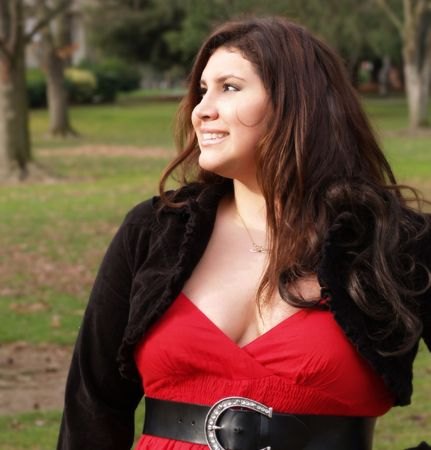 Large woman in autumn outdoor portrait