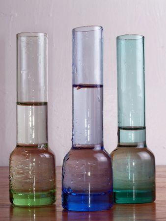 Three beaker shot glasses with liquid       Imagens