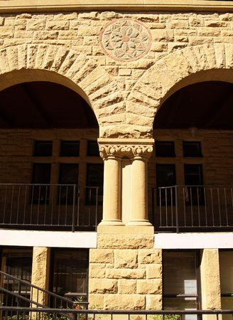 Stone building detail of arches,columns and rosette design