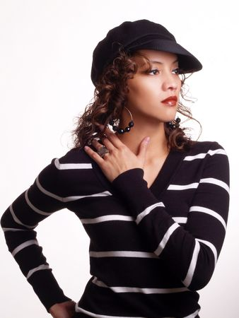 Young woman latina with hat and sweater     Archivio Fotografico