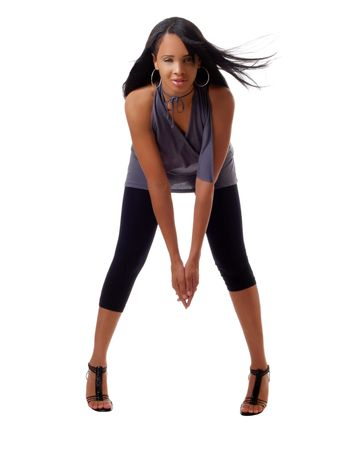 young black woman in leggings and bending forward          photo
