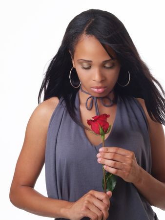 Young black woman holding red rose