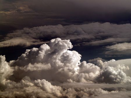Cumulus clouds from the air ominous looking       Stok Fotoğraf