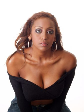 Young black woman with bare shoulders serious look 写真素材