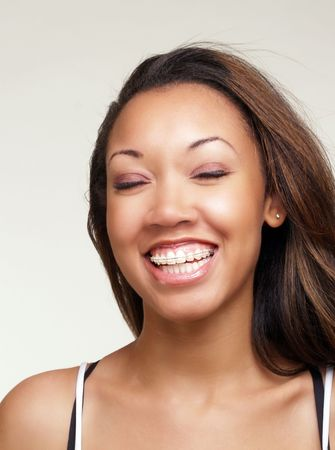 Portrait of young black woman big smile eyes closed        Stock fotó